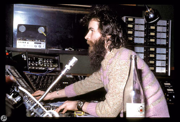 John Burns at the desk in Escape at the time of the 'Planet' session. Behind him you can see the 16-track Studer A80 used to record the original version.