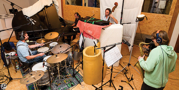 Although the band normally played together in the main recording room (below), all the vocals were recorded in an adjacent DIY vocal booth (above). As a  result, no ambient sound from the singer spilled onto any of the other mics in the setup, so the voice, therefore, didn't blend naturally with the rest of the band in the mix.