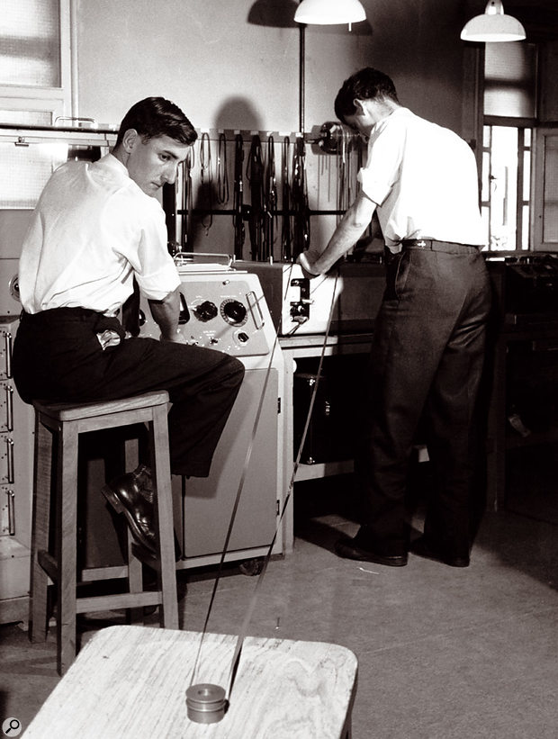 Dick Mills (left) and studio manager John Harrison attempt to control a very long tape loop!