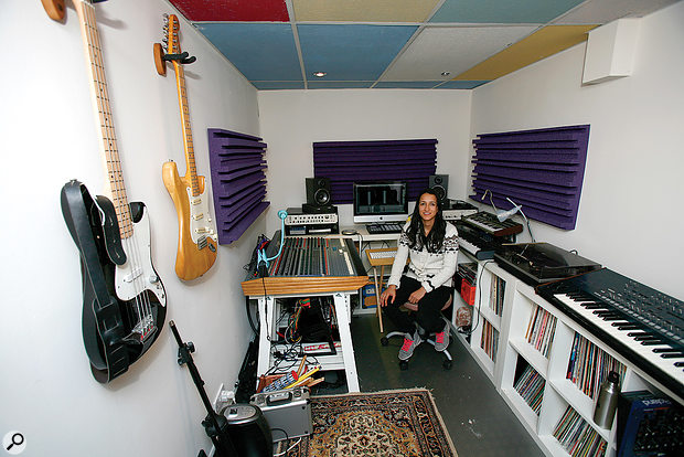 Sunita in her newly improved studio. The foam helps to improve the monitoring accuracy by absorbing early reflections from the walls, and the guitar hangers keep the instruments safe, while reclaiming some of her floor space!