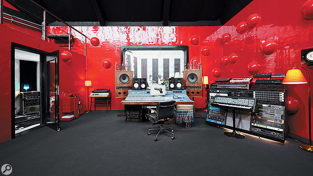 This view of the Delta Lab control room shows some of Thomas Troelsen's synths. All are triggered simultaneously when anote is played on his master keyboard.