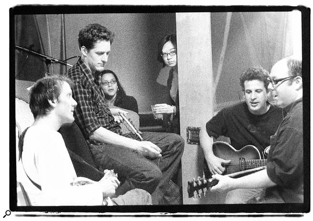 Arif Mardin puts Norah Jones (back, third from left) and her band through their paces.