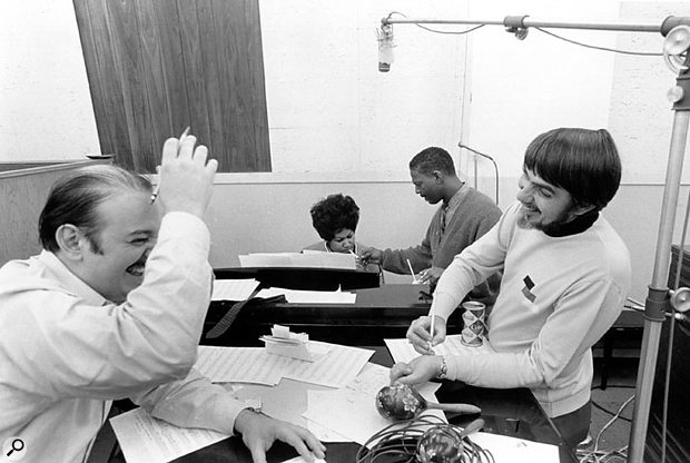 A younger Arif Mardin at Muscle Shoals with Aretha Frankin (back) and Tom Dowd (right).