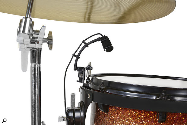 The drum-mounting system hooks around the drum's tuning lug; the extended bolt allows the drum to be tuned while the mic is mounted.