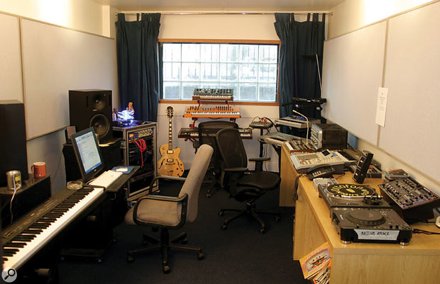 One of the programming suites at the new facility is itself a dream project studio, with a treasure trove of fantastic kit. The keyboards at the far end are a Moog Prodigy, a Waldorf Microwave XT, and a Roland Juno 60, while off to the right there's a No1derland Stereo Theremin, an Access Virus Indigo 2, and a Korg Triton. There are more rackmount synths and sound sources next to the guitars on the left, including an Oberheim Matrix 1000, Novation Drumstation, Roland MKS70 and JV1080, with a Focusrite ISA430 channel strip. The worksurface on the right seems more dedicated to rhythm creation, with a Korg Microkorg synth, Electrix Filter Factory and MOFX processors, an Akai MPC3000 sampling workstation and a Roland SH101 monosynth, a Korg Electribe RX rhythm box and two Kaoss Pad controllers (an original and a MkII model). Finally, there's a Technics vinyl deck, a Pioneer CD turntable, and a Numark DJ mixer. A selection of vinyl can just be seen under the table, with the Residents and the Beatles to the fore! Just out of shot by the master keyboard and Pro Tools rig on the left of the room is a large screen for use in Davidge and Del Naja's music-for-picture work.