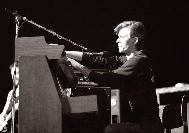 David Bowie on tour in 1977, playing keyboards in Iggy Pop's backing band.