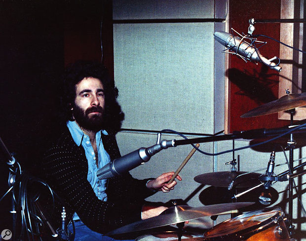 Kevin Godley at the drum kit during the recording of the Original Soundtrack album, where close miking and portable screens were used to create a very dead sound.