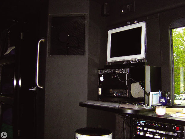 The workstation area of the bus with vocal booth behind and to the left.