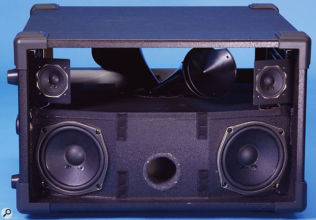 The 2101 with its grille removed, revealing the treble horn, five-inch woofers and two-inch tweeters.