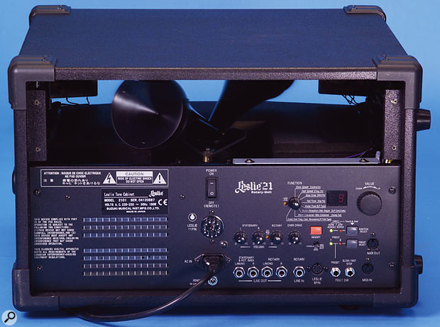 The involved connection panel of the Leslie 2101. There are four inputs, one of which comes via the quarter-inch input jack, while the others are carried via the 11-pin connector. The digital Leslie simulator is controlled by the buttons, knob and Value dial on the right. Footswitch and MIDI control is also available, and the knobs in the middle govern the output levels of the stationary speakers, the rotary horn, and the rotary amp's overdrive. The four outputs are at the bottom.
