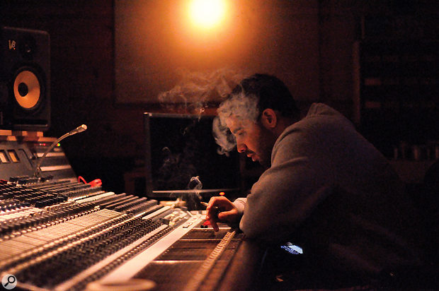 Drake studies the console at Metalworks Studios, where 'Headlines' was mixed.