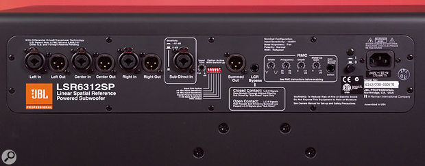 The rear panel of the LSR6312 subwoofer houses the main XLR and combo audio connections (left) plus the Room Mode Correction controls at the right.