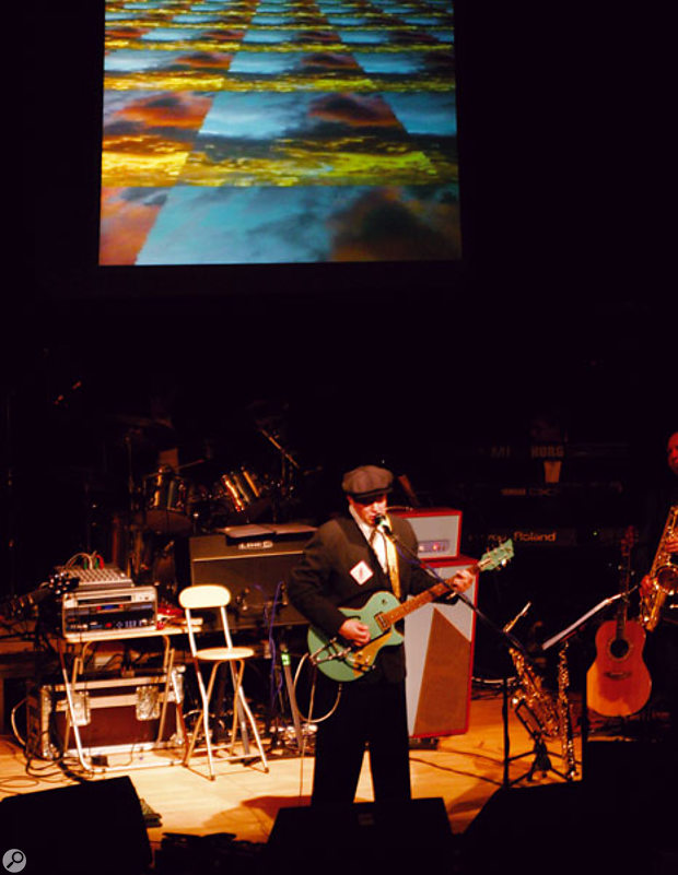 Bill Nelson live on tour in Autumn 2004, with the KPE1/Krossfour combination providing video effects on the screen behind him.