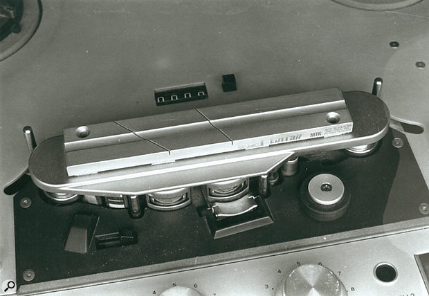 A cutting block for quarter-inch tape with 45- and 60-degree guide grooves.
