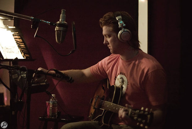 For Lullabies To Paralyze, Joe Barresi deliberately chose different miking setups for different tracks. Here, QOTSA main man Josh Homme is miked up to capture both his vocal and the strings of his hollow-bodied electric guitar.
