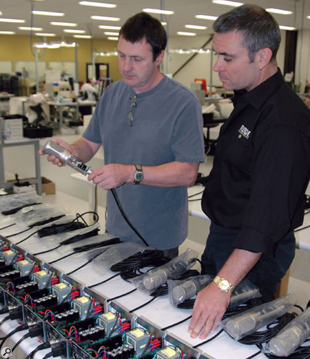 SOS Editor In Chief Paul White and Peter Freedman of Rode checking out mics being tested at the Rode factory in Sydney.