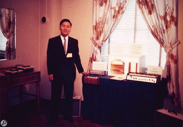 Ikutaro Kakehashi, founder of Roland, at the 1964 NAMM show with the Ace Electronics R1 and Canary.