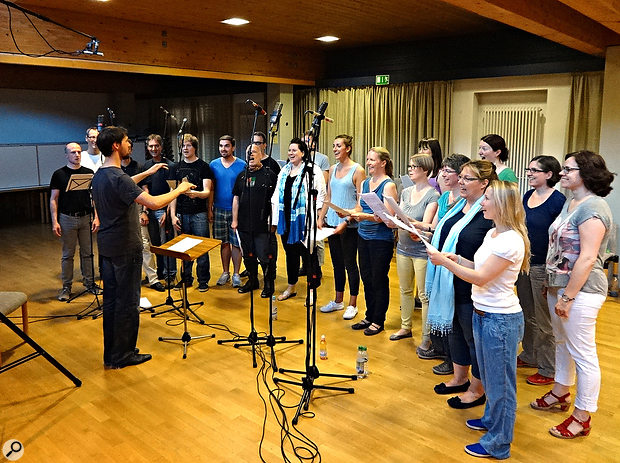 Recording a mixed-voice choir in a rehearsal room. To allow scope for adding in a more suitable church-style ambience at mixdown, the main stereo pair (above the conductor's head) were cardioid mics, and supplemented with per-section close mics for soprano, alto, tenor, and bass sections.