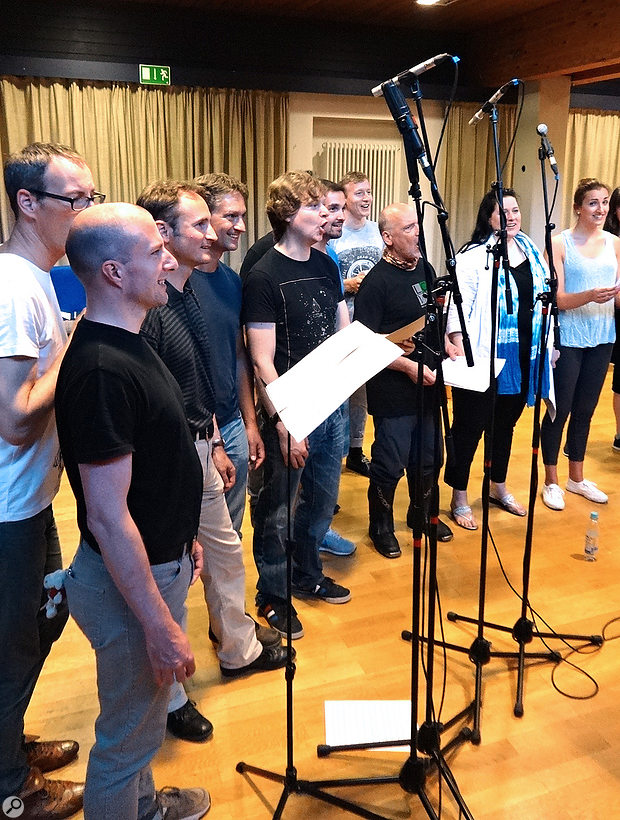 Although the close mics were all three to four feet from the singers, and well above mouth level, the sound from the condensers was thin and brittle-sounding on account of the small-diaphragm mics' inherent on-axis high-frequency emphasis.