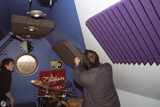 As an attempt to dry up the sound further, Paul fixed more foam to the wall behind the drums.