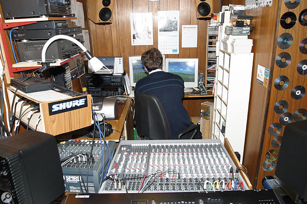 Peter's studio layout was less than ideal for mixing in software — when seated at the computer, the main monitors were set up directly behind him.