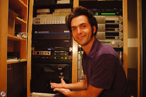 Dweezil Zappa shows off the Verari dual-Opteron PC in the UMRK machine room.