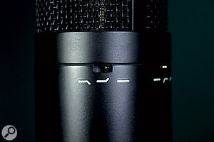 Common to both microphones is this three-position Character switch, whi