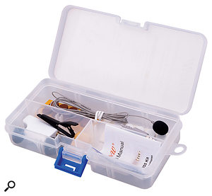 The i825 is supplied in a neat storage box and includes two tan and two black foam windshields plus 10 self-adhesive strips. Also included are two crocodile clips, and an adaptor that allows the mic and a pair of conventional earphones or headphones to be connected to the iOS device simultaneously.