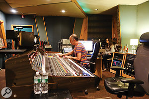 Joe Costa (left) and assistant Gena Johnson at Grand Victor's API console.