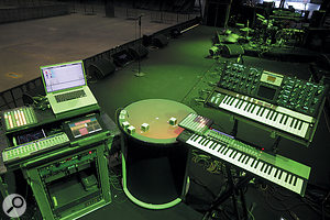 Matt's MIDI rig. The Novation controllers and JazzMutant Lemur on the left are used for tweaking the drum samples in real time. The Moog Voyager on the right plays bass on most of the songs, while the Novation Remote SL 61 controls the Tesla coil and triggers samples in Ableton. In the centre is the highly unusual Reactable synth.