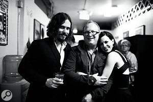 The Civil Wars celebrate with Charlie Peacock after asuccessful gig.