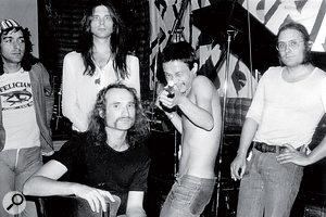 The classic Can line‑up in Inner Space Studios. From left: Jaki Liebezeit, Michael Karoli, Holger Czukay (front), Damo Suzuki and Irmin Schmidt.