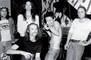 The classic Can line‑up in Inner Space Studios. From left: Jaki Liebezeit, Michael Karoli, Holger Czukay (front), Damo Suzuki and Irmin Schmidt.