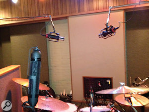 Joe Chiccarelli snapped these camera-phone shots during the tracking at Sunset Sound, showing (above) his drum-mic overhead setup with a pair of Manley Reference Cardioids; and (right) an AEA R88 stereo ribbon mic and the AKG C12 used to record Morissette's vocals.