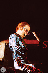 Elton John on stage at the Hammersmith Odeon, 1973.