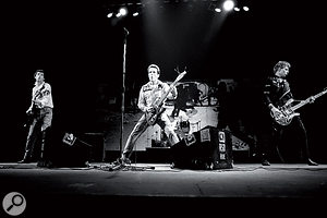 The Clash on stage at the Rainbow Theatre, 1977. From left to right: Mick Jones, Joe Strummer and Paul Simonon.