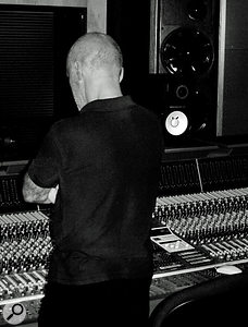 Chris Birkett looking thoughtful at the desk in Eden Studios.