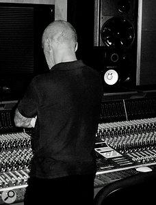 Chris Birkett looking thoughtful at the desk in Eden Studios.
