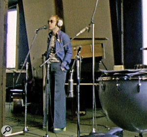Elton John in the Château d'Hérouville's live room. Behind him you can see Gus Dudgeon's piano isolation box on top of the grand piano.
