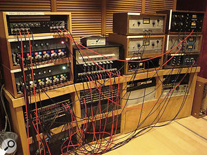 Outboard gear in Fantasy's Studio Acontrol room. On the left‑hand side is arack of five Neve 8078 mic pres above two racks of six Neve 8078 mic pres. To the right of these is arack of Telefunken 672 eight mic pres and, further to the right, apair of Teletronix LA2A Tube Limiters, beneath which is aDBX 160 Compressor/Limiter. At the far right are apair of Urei LN 'black face' 1176s and a pair of 'blue stripe' 1176s with an LN upgrade.