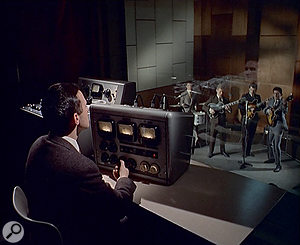 Ray Prickett looking down from the control room into the live room of Pye's Studio 1.