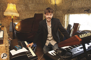 Only one man would be crazy enough to bring agrand piano to afestival... Joe Leach in the Cowshed keyboard area.