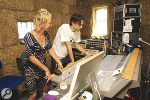 Silvia Vermeulen and Teo Miller at work on the Audient desk.