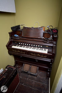 DK Studios is also home to some non-electronic instruments, including a harmonium and an upright piano.