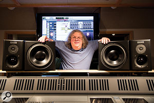 Mick Guzauski with his custom monitor speakers, which have the woofer mounted in a separate enclosure from the mid- and high-frequency drivers.