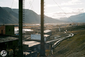 """The entire settlement of Pyramiden was abandoned suddenly in 1998, in mysterious circumstances. Rasmus: """"Aphoto with the power plant in the foreground and the rest of the settlement in the background. Athousand people used to live here.""""  The rhythm track to the song 'Dreams Today' is based on arecording of CasperClausen running along one of the longwooden walkways."""