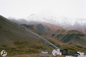 """Rasmus: """"This is the mine buildings. The mountain is the Pyramid Mountain which gave name to the settlement. The top of it behind the clouds looks like apyramid."""""""