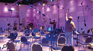 Technicians setting up a'microphone forest' for an orchestral sampling session at EastWest's Studio 1.