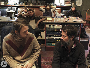 Fleet Foxes, with Robin Pecknold front left, listen back to their work at the end of along day.
