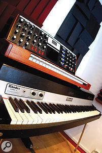 Hardware keyboards include a Moog Voyager and a Rhodes piano.